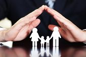 stock photo of chains  - Female hands and chain family on wooden table - JPG