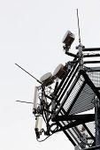 foto of telecommunications equipment  - telecommunication equipment on top of antenna tower - JPG
