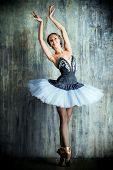 foto of ballet dancer  - Professional ballet dancer posing at studio over grunge background - JPG