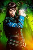 stock photo of elf  - Beautiful warrior elf with a dagger in his hand in the magic forest - JPG