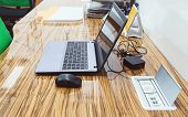 picture of peripherals  - Modern office table with necessary accessories computer and peripherals and power supply built in table - JPG