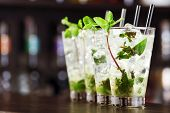 image of mojito  - Mojito cocktails shot on a bar counter in a nightclub - JPG