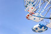 picture of ferris-wheel  - Ferris Wheel at the county fair with the sky in the background - JPG