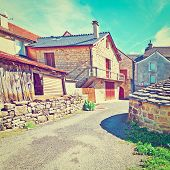 stock photo of french culture  - Deserted Street of the French City of Les Salelles Retro Effect - JPG