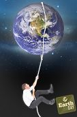 foto of twinkle  - Businessman pulling a rope against stars twinkling in night sky - JPG