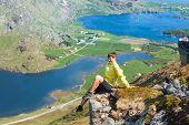 stock photo of lofoten  - Sporty woman on the top of a mount Holandsmelen - JPG