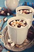 stock photo of milk  - Delicious chocolate milk made from almond milk with marshmallow and almond chips - JPG