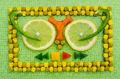 stock photo of corn  - background of peas and corn laid by hand - JPG