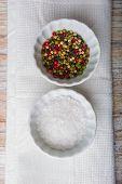 foto of salt-bowl  - Salt and pepper in white bowls - JPG