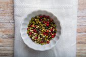 picture of peppercorns  - Colored peppercorns in a white bowl - JPG