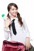picture of teen pony tail  - Girl standing with bottle of yogurt at her school desk - JPG