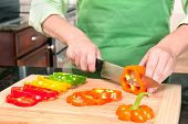 Woman Slicing Bell Peppers