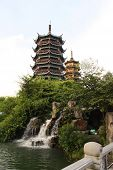 Two Pagodas and a waterfall in Guiling, China