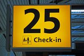 Yellow airport check-in sign