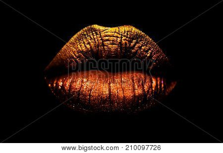 poster of Golden Brown Lipstick On Lips Isolated On Black Background. Sexy Lips, Female Mouth. Imprint Lips. L
