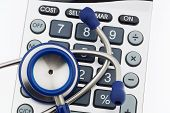stock photo of health-care  - A stethoscope and a calculator - JPG