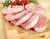 foto of charcuterie  - Raw pork chops on a cutting board and vegetables - JPG