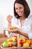 Woman eating Obstsalat