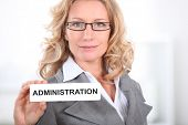 Blond office worker holding administrator  badge