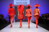 MOSCOW - FEBRUARY 22: Models show the backs of four suits from Slava Zaytzev and walk catwalk in Col