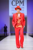 MOSCOW - FEBRUARY 22: A model wears a red suit from Slava Zaytzev and walks the catwalk in the Colle