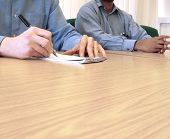 pic of business meetings  - Taking notes at a business meeting - JPG
