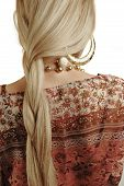 Plait of a young blond girl. Woman back with braided hair.