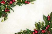 Christmas decorative background border on parchment paper with red bauble decorations, holly, mistle poster