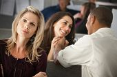 stock photo of threesome  - Woman envies coworker - JPG