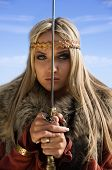stock photo of armor suit  - Portrait of the blonde girl in the Scandinavian suit with sword - JPG