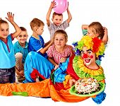 Birthday child clown playing with children and bunny fingers prank. Kid holiday cakes celebratory an poster