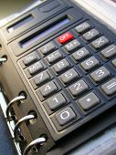picture of statistician  - calculator of notebook  - JPG