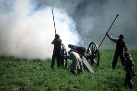 picture of rebs  - Artillery fires their gun during civil war re enactment - JPG