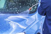 Manual Car Wash With Pressurized Water In Car Wash Outside.cleaning Car Using High Pressure Water. poster
