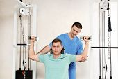Patient Exercising Under Physiotherapist Supervision In Rehabilitation Center poster