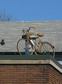 Rooftop bicycle recycling sign