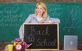 School. Home Schooling. Happy Woman. Teacher With Alarm Clock At Blackboard. Back To School. Teacher poster