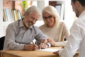 Happy Older Couple Clients Sign Insurance Contract Meeting Agent poster