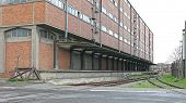 Big Warehouse Building With Railway Loading Dock poster