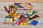 Stationery Supplies On Wooden Background. Workspace With Assorted School Or Office Items. Back To Sc poster
