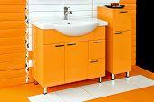 image of lavabo  - White basin with orange ceramics in bathroom - JPG