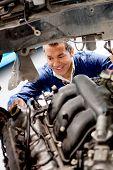 Man fixing mechanical problem on a car