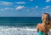 Sexy Woman On A Beach Looking Far On Horizon