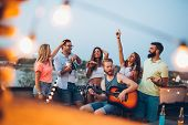 Group Of Carefree Friends Dancing Have Fun In Summer poster