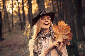 Autumn Woman. Carefree Young Woman In Trendy Vintage Pullover Or Sweater. Surprise Autumn Woman. Rom poster