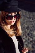 Pretty Woman In Hat And Sunglasses And Furry Vest Urban Background. Fall Fashion Accessory. Enjoy Fa poster