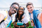 Selfie Mania. Three International Students With Beaming Smiles Are Posing For Selfie Shot, Caucasian poster