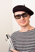 image of french beret  - French artist in beret with three brushes - JPG