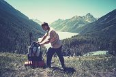 Man Traveler With Backpack Mountaineering Travel Lifestyle Concept. Altai, Siberia, Russia. Backpack poster