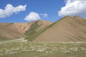 Green Hills And Pastures Against The Blue Sky With Clouds. Travel. Kyrgyzstan. poster